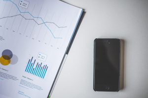 iPhone and documents containing graphs and charts