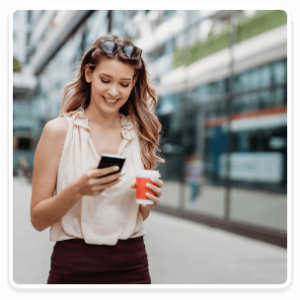 Woman with coffee on phone